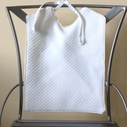 White Matelasse with Natural Cotton Piping Bib